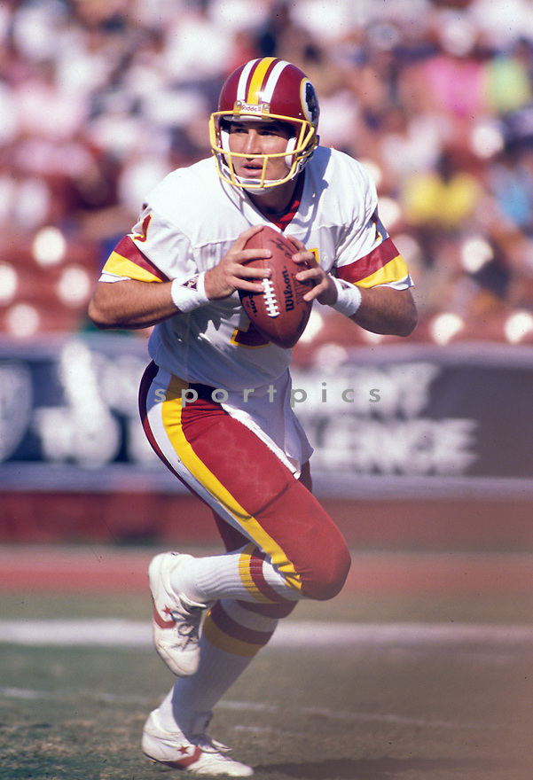 Washington Redskin Mark Rypien(7) in action during a game against the Los Angeles Raiders at Los Angeles Memorial Coliseum in Los Angeles, California on October 29, 1989.  The Raiders beat the Redskins 37-24. Mark Rypien played for 11 years  with 5 different teams and was a 2-time Pro Bowler.David Durochik/SportPics
