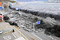 March 11, 2011: Black waves overwhelmed a levee, swallowing a seaside village near the mouth of Hei River, 3:21PM on March 11, 2011.(Photo by Mainichi  Newspaper / Aflo)