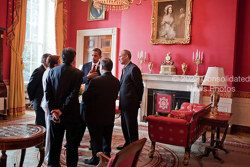 Washington, DC - August 12, 2009 -- United States President Barack Obama and Assistant to the President for Legislative Affairs Phil Schiliro, right, talk with others in the Red Room following a reception for Supreme Court Justice Sonia Sotomayor at the White House, August 12, 2009..Mandatory Credit: Pete Souza - White House via CNP
