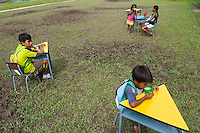 Indigenous children take their school lunch break - Communidad Siete de Augosto - Amazonas - Colombia