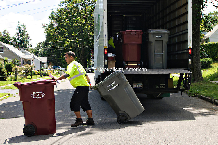 NAUGATUCK, CT - 30 July 2012-073012EC01--    Gabriel Lucich delivers new recycling trash bins to Naugatuck homes Monday afternoon.  New automated trucks will feature a robotic arm to carry away trash.  Erin Covey Republican American.