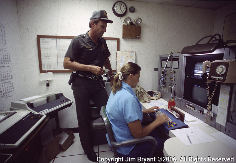 A U.S. Border Patrol agent in Del Rio, Texas. checks the data base of illegal aliens.  While the traditional mission of the United States Border Patrol has always been the detection and prevention of the illegal entry of aliens and smuggling of illegal contraband into the United States anywhere other than a designated port-of-entry, the dawn of the age of terrorism within our nation has added a new and high priority mission: to detect and prevent the entry of terrorists and their weapons into the United States. Jim Bryant Photo..©2006. All Rights Reserved.