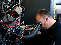 Mar 16, 2014; Gainesville, FL, USA; A crew member for NHRA top fuel driver Steve Torrence (not pictured) works on the engine in the pits during the Gatornationals at Gainesville Raceway Mandatory Credit: Mark J. Rebilas-USA TODAY Sports