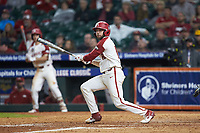 Casey Opitz (12) of the Arkansas Razorbacks follows through on his swing against the Baylor Bears in game nine of the 2020 Shriners Hospitals for Children College Classic at Minute Maid Park on March 1, 2020 in Houston, Texas. The Bears defeated the Razorbacks 3-2. (Brian Westerholt/Four Seam Images)