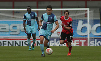 Andrew Fleming of Morecambe chases down the attack of Luke O'Nien of Wycombe Wanderers during the Sky Bet League 2 match between Morecambe and Wycombe Wanderers at the Globe Arena, Morecambe, England on 29 April 2017. Photo by Stephen Gaunt / PRiME Media Images.