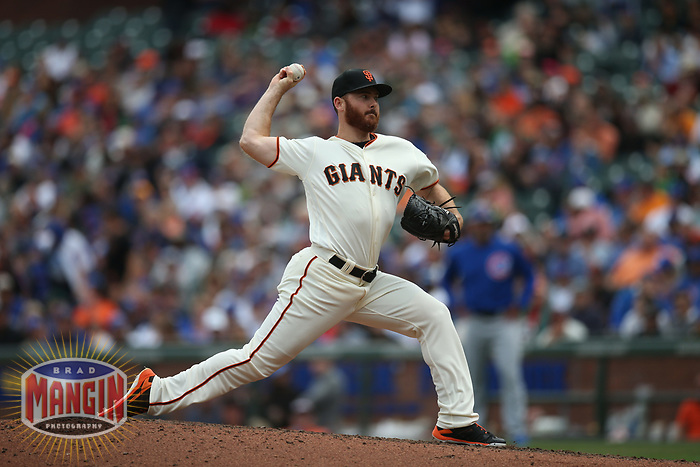 SAN FRANCISCO, CA - AUGUST 9:  Sam Dyson #49 of the San Francisco Giants pitches against the Chicago Cubs during the game at AT&T Park on Wednesday, August 9, 2017 in San Francisco, California. (Photo by Brad Mangin)