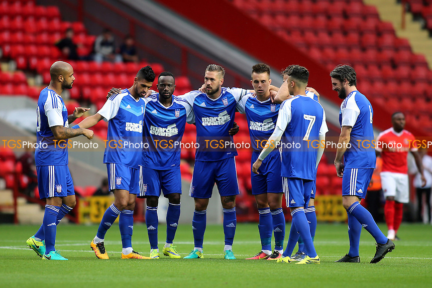 Ipswich Town players get ready for a pre-match huddle during Charlton Athletic vs Ipswich Town, Friendly Match Football at The Valley on 26th July 2016