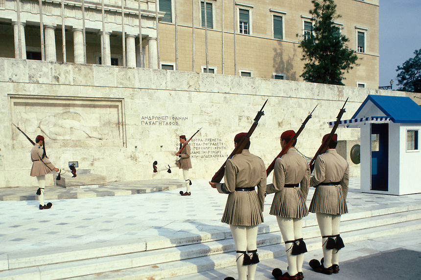 "Evzone (meaning ""well-armed man"") in their traditional costume, prepare for a ritual changing of the Honor Guard at the Tomb of the Unknown Soldier. Constitution Square in Athens."
