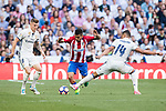 Angel Correa (c) of Atletico de Madrid competes for the ball with Carlos Henrique Casemiro (r) of Real Madrid during their La Liga match between Real Madrid and Atletico de Madrid at the Santiago Bernabeu Stadium on 08 April 2017 in Madrid, Spain. Photo by Diego Gonzalez Souto / Power Sport Images