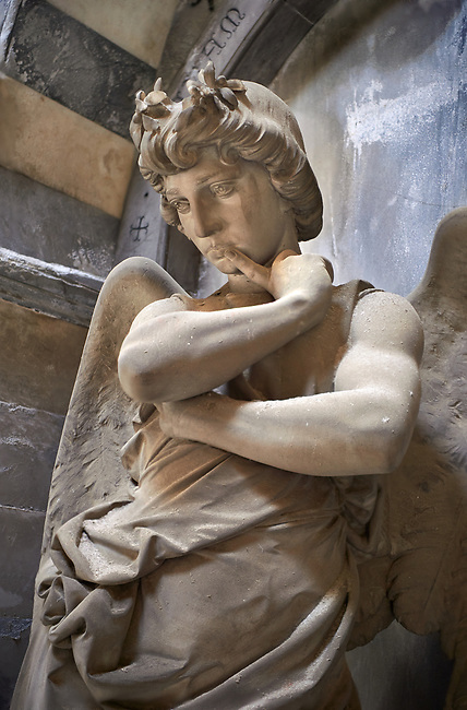 Picture and image of the stone sculpture of an agel in thought at the door of the tomb of the Mantero family. Art Nouveau style sculpted by L Orengo 1895. Section B, no 04, The monumental tombs of the Staglieno Monumental Cemetery, Genoa, Italy