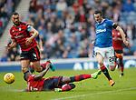 07.04.2018 Rangers v Dundee:<br /> Jamie Murphy skips past Steven Caulker and the leg of Genseric Kusunga