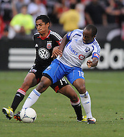 Montreal Impact midfielder Collen Warner (18) shields the ball from D.C. United midfielder Andy Najar (14) D.C. United defeated Montreal Impact 3-0 at RFK Stadium, Saturday June 30, 2012.
