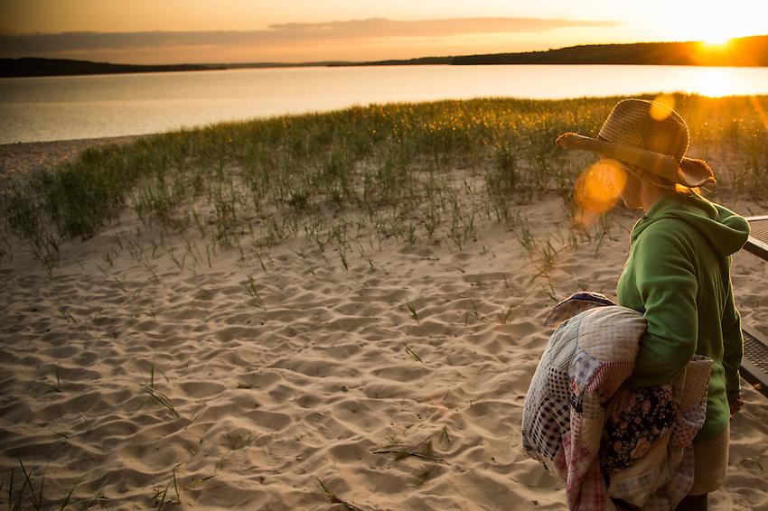 Walking a Lake Superior beach at sunset in Munising, Michigan.