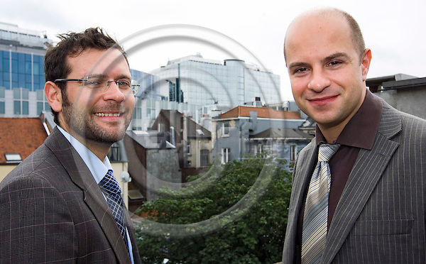 BRUSSELS - BELGIUM - 26 JULY 2007 -- Timme DØSSING (Le) (Doessing, Dossing) and Jacob LUND NIELSEN founders of the Cabinet DN consulting company, on the terrace of their office building with the view to the EU-Parliament.-- PHOTO: JUHA ROININEN / EUP-IMAGES