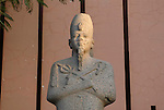 This Osiride red granite statue of Amenhotep III was made for the temple at Luxor.The features are those of the pharaoh in the second part of his reign.A century later,Rameses II usurped the statue and added his title, as was common at the time.The statue now stands in the gardens at the museum in Luxor.