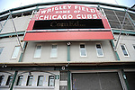 A man stands just behind the gated entrance to Wrigley Field, a Chicago landmark, in Chicago, Illinois on March 23, 2009.