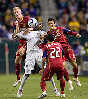 LA Galaxy forward Edson Buddle (14) is tripled teamed by Real Salt Lake defenders Nate Borchers (6-l), Tony Beltran (2-r) and midfielder Nelson Gonzalez (22-foreground). The LA Galaxy defeated Real Salt Lake 2-1 at Home Depot Center stadium in Carson, California on Saturday April 17, 2010.  .