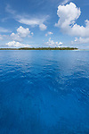 Apataki Atoll, Tuamotu Archipelago, French Polynesia; view of  the palm tree covered islands bordering  Apataki Atoll