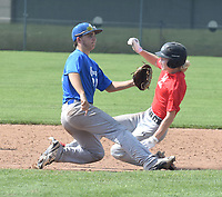 RICK PECK/SPECIAL TO MCDONALD COUNTY PRESS McDonald County's Wyatt Jordan steals second base during the McDonald County 18U baseball team's 6-5 loss on June 2 to Carthage in the Carl Junction 18U Baseball Tournament at Carl Junction High School.