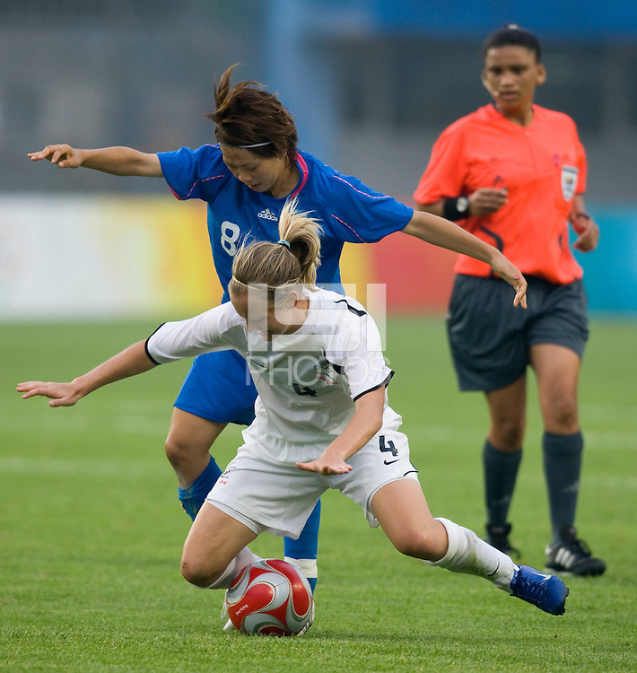 New Zealand midfielder (4) Katie Hoyle is fouled by Japanese midfielder (8) Aya Miyama during first round play in the 2008 Beijing Olympics at Qinhuangdao, China. .  Japan tied New Zealand, 2-2, at Qinhuangdao Stadium.