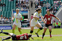EmilyScarrattof England breaks through the tackle of Landry during the iRB Challenge Cup at Twickenham on Sunday 13th May 2012 (Photo by Rob Munro)