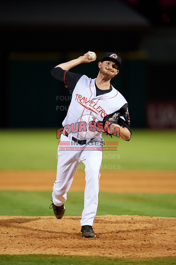 Arkansas Travelers relief pitcher Blake Perry (18) delivers a pitch during a game against the Midland RockHounds on May 25, 2017 at Dickey-Stephens Park in Little Rock, Arkansas.  Midland defeated Arkansas 8-1.  (Mike Janes/Four Seam Images)