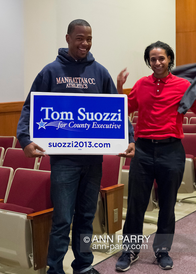 Old Westbury, New York, U.S. 8th October 2013. Supporters for both candidates brought signs to the Nassau County Executive Candidates Debate, including these two young men leaving after the debate was over. The debate between Mangano and Suozzi was hosted by the Nassau County Village Officials Association, representing 64 incorporated villages with 450,000 residents, as the opponents face a rematch in the 2013 November elections.