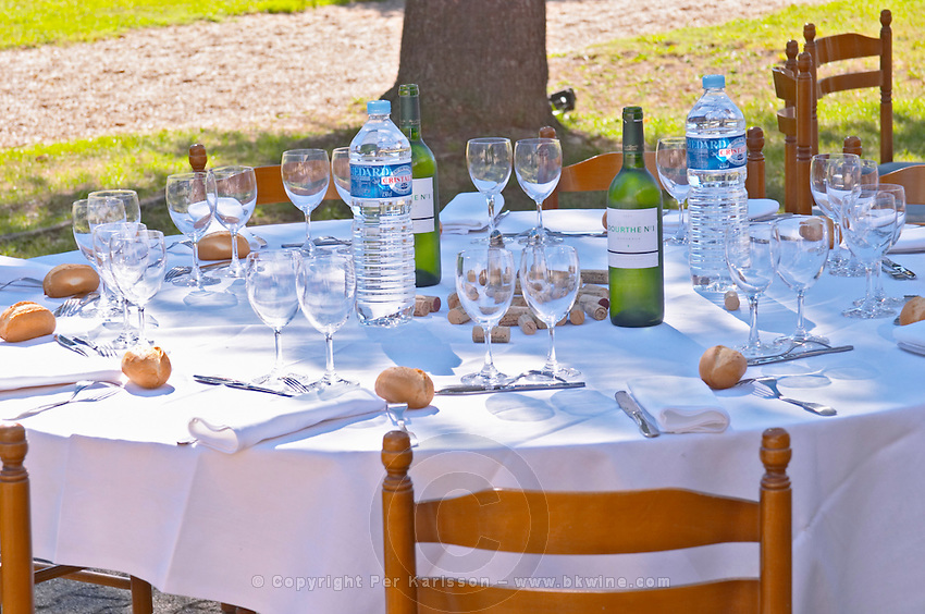 A table set for lunch in the garden a sunny autumn day - Château Pey la Tour, previously Clos de la Tour or de Latour, Bordeaux, France