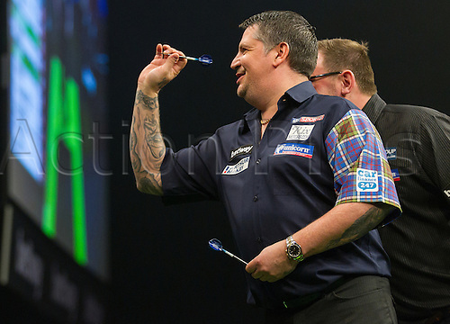 31.03.2016. The Motorpoint Arena, Cardiff.  Betway PDC Premier League Darts Judgement Night. Gary Anderson and James Wade share a joke before the match