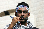 A Palestinian youth holds a knife during an anti-Israeli protest in Rafah n the southern Gaza Strip, October 20, 2015. Triggered by Israeli incursions into the Al-Aqsa Mosque compound last month, violence and protests against Israel's occupation have increased in frequency across the West Bank, including East Jerusalem, and the Gaza Strip. Photo by Abed Rahim Khatib