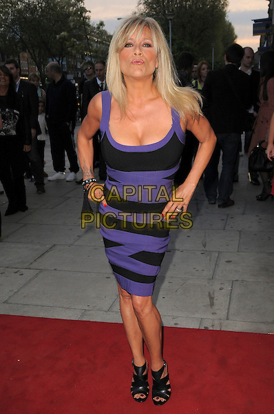 "SAMANTHA FOX.The ""City Rats"" East End Film Festival VIP Screening, Genesis Cinema, Mile End Road, London, England..April 24th 2009.full length black purple dress handS on hipS booties sandals shoes bending leaning cleavage sam.CAP/CAS.©Bob Cass/Capital Pictures."