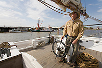 Captian, navigating the Historic Tall Ship, A.J. Meerwald, sailing on the Delaware Bay, Cumberland County, New Jersey