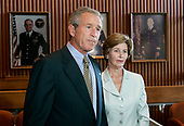 U.S. President George W. Bush and First Lady Laura Bush speak to reporters after visiting injured U.S. soldiers at Walter Reed Army Medical Center in Washington, DC on Wednesday 5 October 2005.<br /> Credit: Matthew Cavanaugh / Pool via CNP