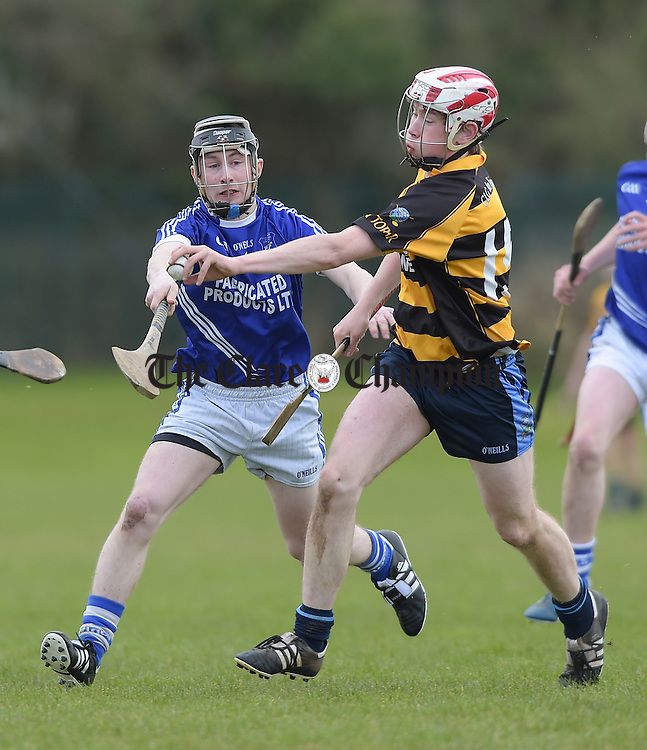 Shane O' Leary of Cratloe in action against Gavin O' Brien of Crusheen-Tubber during their U-21 semi final at Clarecastle. Photograph by John Kelly.