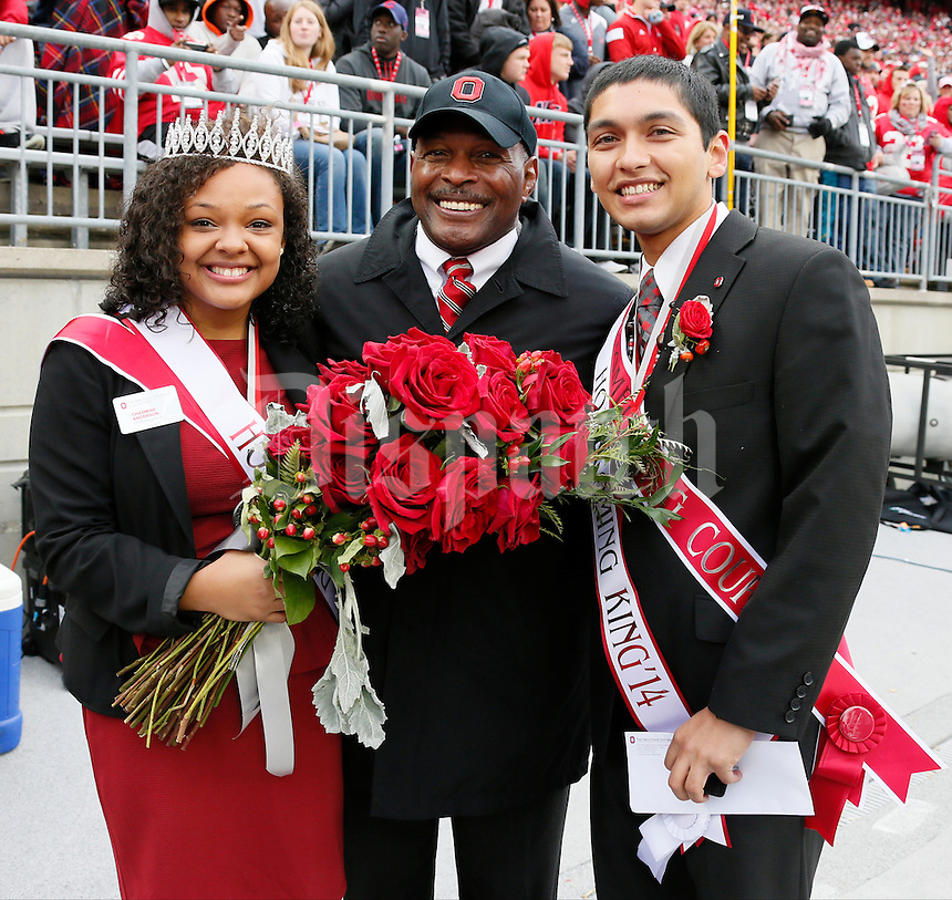 Amit Raghuvanshi and Chasmine Anderson, standing with Archie Miller, were named the 2014 Homecoming King and Queen before Saturday's NCAA Division I football game between the Ohio State Buckeyes and the Rutgers Scarlet Knights at Ohio Stadium in Columbus on Saturday, Oct. 18, 2014. (Dispatch Photo by Barbara J. Perenic)