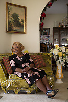 Mrs. Hazeline Umstead, 80, and the house that she has lived in since she was a child in Lyon Park in Durham, NC on Monday, April 10, 2017. (Justin Cook)
