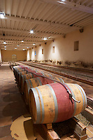 Oak barrel aging and fermentation cellar. Chateau Phelan-Segur, Saint Estephe, Medoc, Bordeaux, France