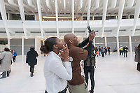 Excited visitors in the partially finished World Trade Center Transportation Hub, known as the Oculus, at its opening on Thursday, March 3, 2016. The over-budget, years late, $4 billion state-of-the-art transportation hub was designed by renowned architect Santiago Calatrava. When finished the hub will connect subway lines and PATH trains. (© Richard B. Levine)
