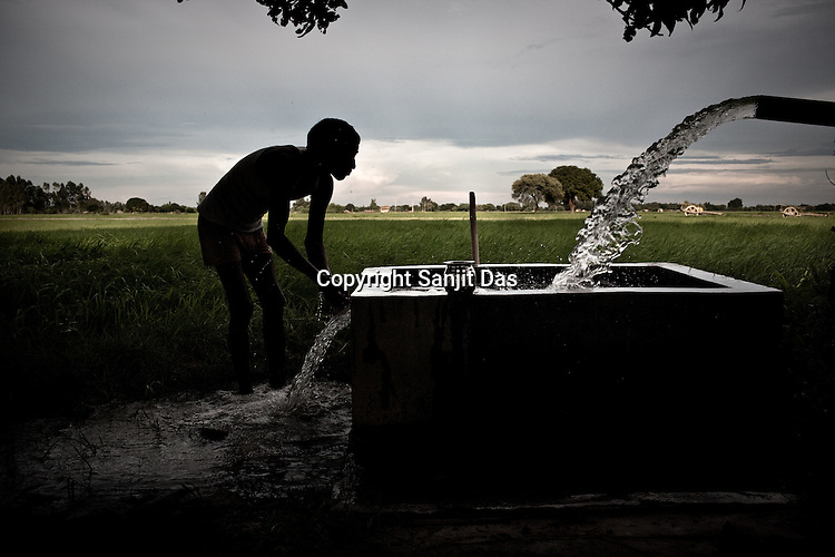 A farmer is seen irrigating his farmland using water pump in Akhori village in Unnao in Rae Bareli, Uttar Pradesh, India. Very few farmers have access to electricity to irrigate their farmland and are totally dependent on rainfall. The 4 month annual rainfall is crucial to summer sown crops as 60% of the farmlands are rainfed. North India experienced scanty rainfall in late june to july. Till August, rain in India has been 26% below 5 year average. Late rains moist the fields but it is not enough for rice, sugarcane, oilseeds and pulses. Late rains also damage the alternate crops that need less water.