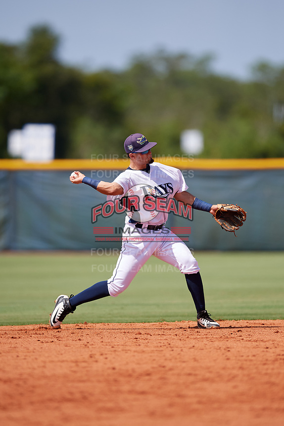 GCL Rays second baseman Cristhian Pedroza (19) throws to first base during a game against the GCL Twins on August 9, 2018 at Charlotte Sports Park in Port Charlotte, Florida.  GCL Twins defeated GCL Rays 5-2.  (Mike Janes/Four Seam Images)
