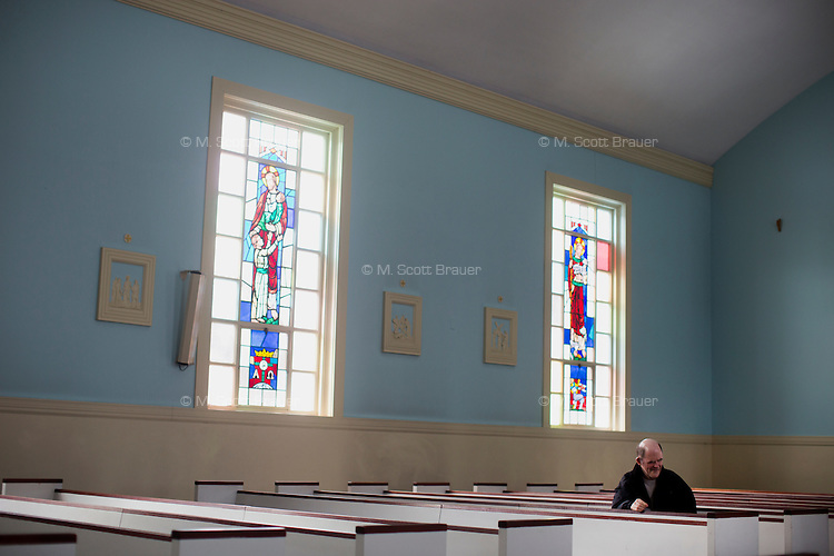 Seen here in the Chapel of the Holy Innocents, Jack Walsh, 62, is a longtime resident of the Fernald Developmental Center in Waltham, Massachusetts, USA.  Jack has been diagnosed with profound mental retardation and cannot speak.