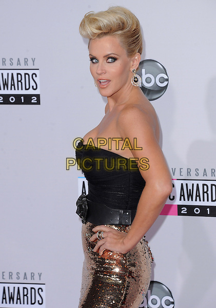 Jenny McCarthy.40th Anniversary American Music Awards - Arrivals held at Nokia Theatre L.A. Live, Los Angeles, California, USA..November 18th, 2012.AMA AMAs half length top gold skirt strapless black sequins sequined hands on hips belt side mouth open.CAP/DVS.©DVS/Capital Pictures.