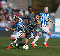 Leicester City's James Maddison avoids the challenge from Huddersfield Town's Tommy Smith <br /> <br /> Photographer Stephen White/CameraSport<br /> <br /> The Premier League - Huddersfield Town v Leicester City - Saturday 6th April 2019 - John Smith's Stadium - Huddersfield<br /> <br /> World Copyright © 2019 CameraSport. All rights reserved. 43 Linden Ave. Countesthorpe. Leicester. England. LE8 5PG - Tel: +44 (0) 116 277 4147 - admin@camerasport.com - www.camerasport.com