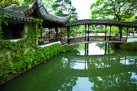 """The Humble Administrator's Garden or Zhouzheng Yuan is considered to be the finest garden in all of southern China.  In 1997, along with other classical gardens of Suzhou was proclaimed a UNESCO World Heritage Site. .The garden's site was initially the residence and garden of Lu Guimeng, a Tang Dynasty scholar. Later it became monastery garden for the Dahong Temple. In 1513 CE, Wang Xiancheng an Imperial Envoy and poet of the Ming Dynasty appropriated the temple. In 1510, he retired to his native home of Suzhou after long service in the East Imperial Secret Service, and began work on the garden. This garden was designed in collaboration with the renowned artist Wen Zhengming.  The garden was named after a verse by Pan Yue's Idler's Prose, """"I enjoy a carefree life by planting trees and building my own house...I irrigate my garden and grow vegetables for me to eat...such a life suits a retired official like me well."""" This verse symbolized Wang's desire to retire from politics and adopt a hermits life."""