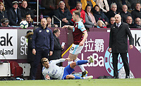 Cardiff City's Joe Bennett goes down under the challenge from Burnley's Ashley Barnes<br /> <br /> Photographer Rich Linley/CameraSport<br /> <br /> The Premier League - Saturday 13th April 2019 - Burnley v Cardiff City - Turf Moor - Burnley<br /> <br /> World Copyright © 2019 CameraSport. All rights reserved. 43 Linden Ave. Countesthorpe. Leicester. England. LE8 5PG - Tel: +44 (0) 116 277 4147 - admin@camerasport.com - www.camerasport.com