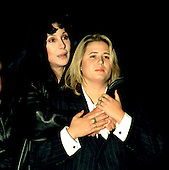 """Cher embraces her daughter, Chastity Bono, before she spoke at the Human Rights Campaign's """"Come out Voting"""" Rally on the Ellipse in Washington, D.C. on October 11, 1996..Credit: Ron Sachs / CNP"""