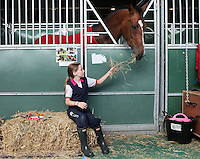 4/8/2010. Sasha Bloch aged 10 from Kildare is pictured in the stables of the Failte Ireland RDS Horse Show. Picture James Horan/Collins Photos