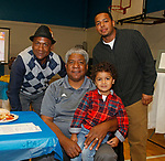 Waterbury, CT 102117MK12 (from left in back) Bruce Johnson, Terence Lott jr., Ken Sinclair with his grandson Kingseley Sinclair gathered at the Steak & Burger Dinner - Come Back to the Club celebration at the Boys & Girls Club of Greater Waterbury on Thursday evening.   Michael Kabelka / Republican-American