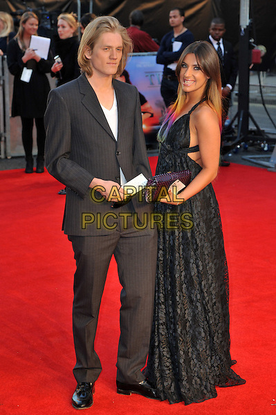 Richard Dinan and Gabriella Ellis.'Titanic 3D' world premiere, Royal Albert Hall, London, England..27th March 2012.full length black lace suit side purple dress clutch bag .CAP/BF.©Bob Fidgeon/Capital Pictures.