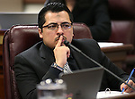 Nevada Assemblyman Edgar Flores, D-Las Vegas, works in committee at the Legislative Building, in Carson City, Nev., on Wednesday, Feb. 18, 2015. <br /> Photo by Cathleen Allison